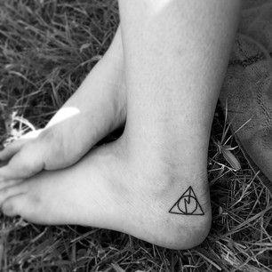 Stunning black Harry Potter tattoo