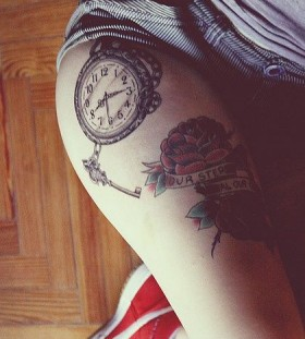 Watch and simple compass tattoo on leg