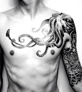 White shoulder and octopus tattoo on arm