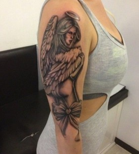 Women black angel tatoo on arm