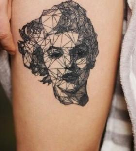 Women's face geometric tattoo on leg