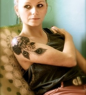 Women's shoulder black peacock tattoo