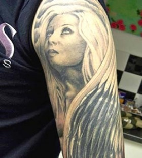 Wonderful looking angel tattoo on arm