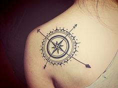 Wonderful looking compass tattoo on back