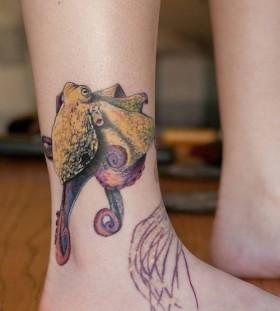 Yello, purple octopus tattoo on leg