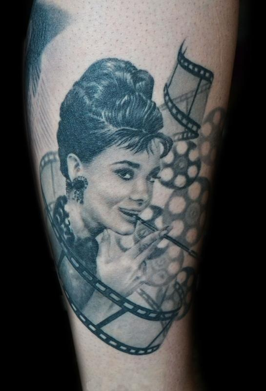 audrey with movie reels tattoo