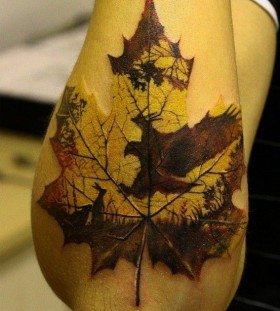 autumn leave tattoo on arm