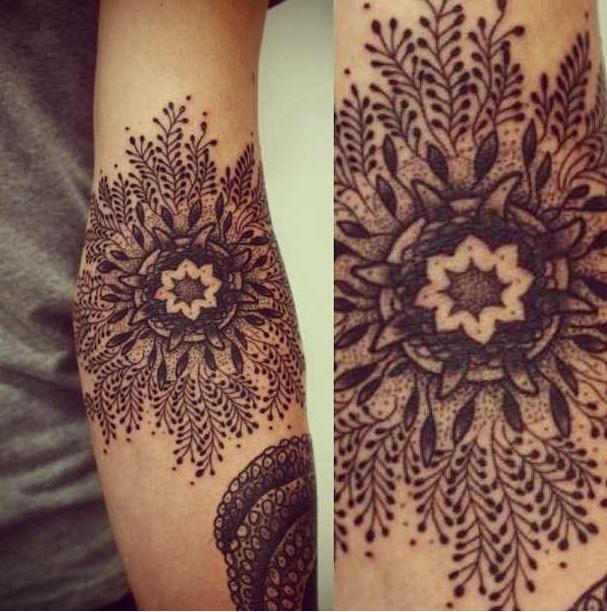 beautiful snowflake tattoo on arm