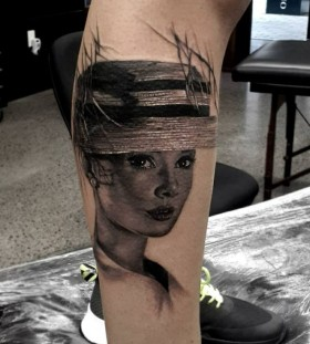 black and white audrey tattoo on leg