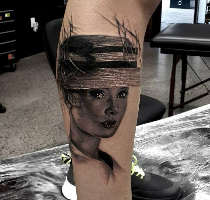 black and white audrey tattoo on leg