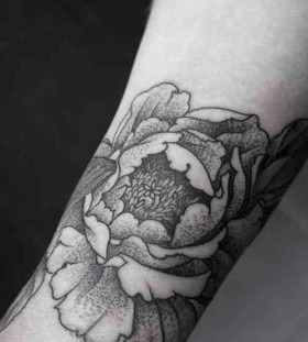 black and white wrist tattoo