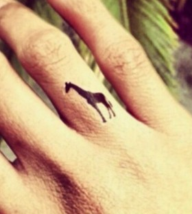black giraffe tattoo on finger