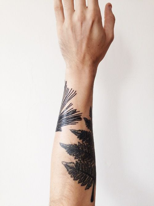 black leaves tattoo on hand