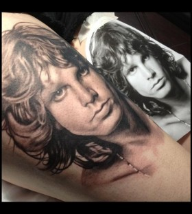 jim morrison portrait tattoo on arm