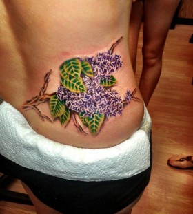 large lilac tattoo on the back