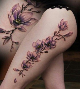 large lilac tattoo on thigh