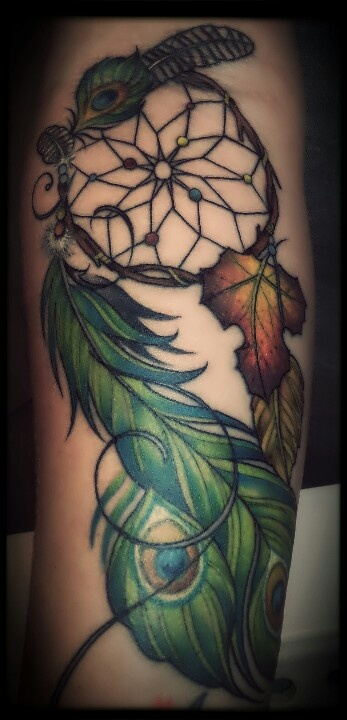 leaves with feather tattoo