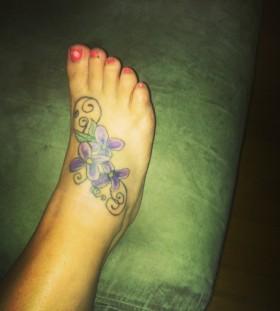 lilac tattoo on foot