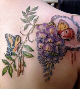 lilac with butterfly tattoo on the shoulder and back