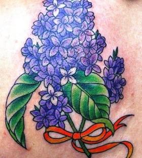 lilac with orange ribbon tattoo
