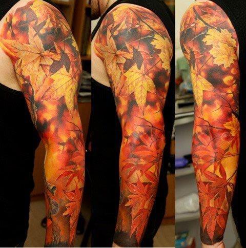 multicolored autumn leaves tattoo