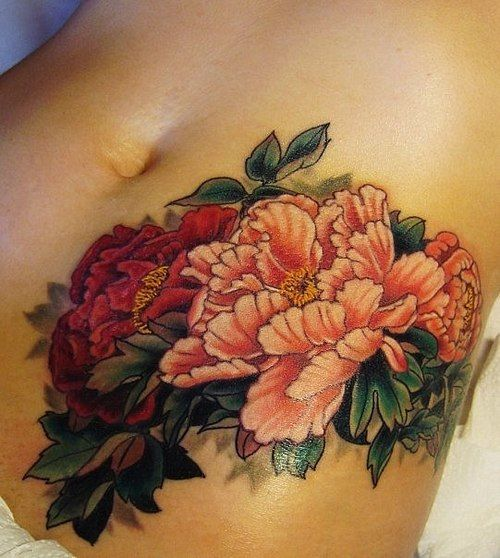 peonies on stomach tattoo