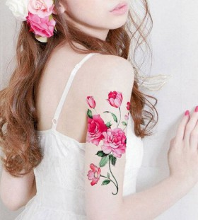 rose and peony arm tattoo