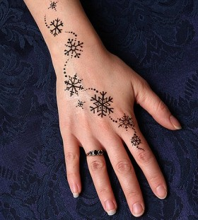 snowflake tattoo on arm