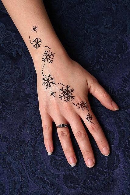 snowflake tattoo on arm