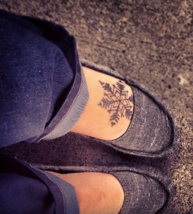snowflake tattoo on foot