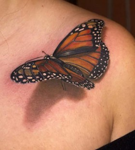 3D butterfly on shoulder tattoo