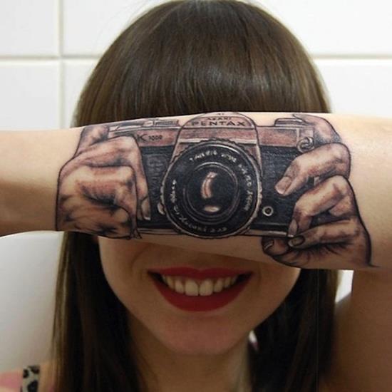 3D camera on arm tattoo
