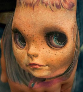 3D creepy doll on hand tattoo