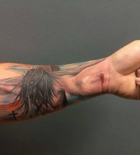 3D crussified Jesus on arm tattoo