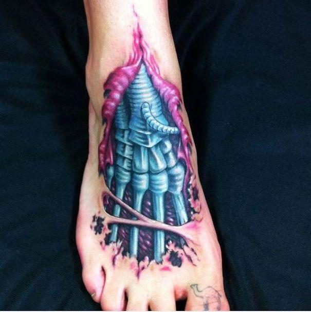 3D neon skeleton on foot tattoo