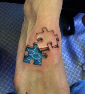 3D puzzle effect with scales on foot tattoo