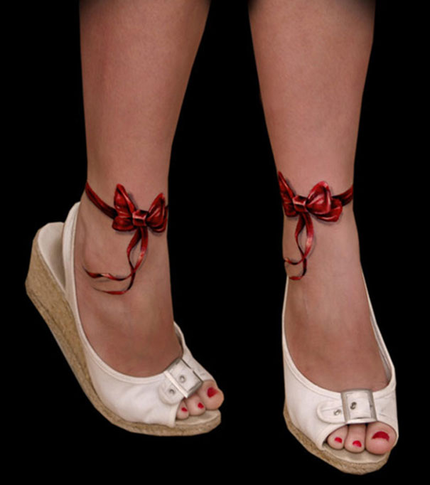 3D red ribbons on ankle tattoo