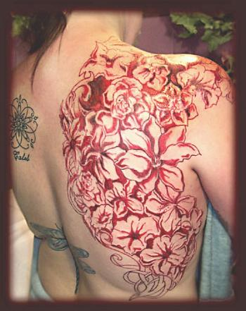 Flower Upper Back Tattoo