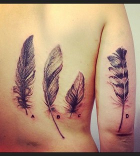 4 feathers back and arm tattoos