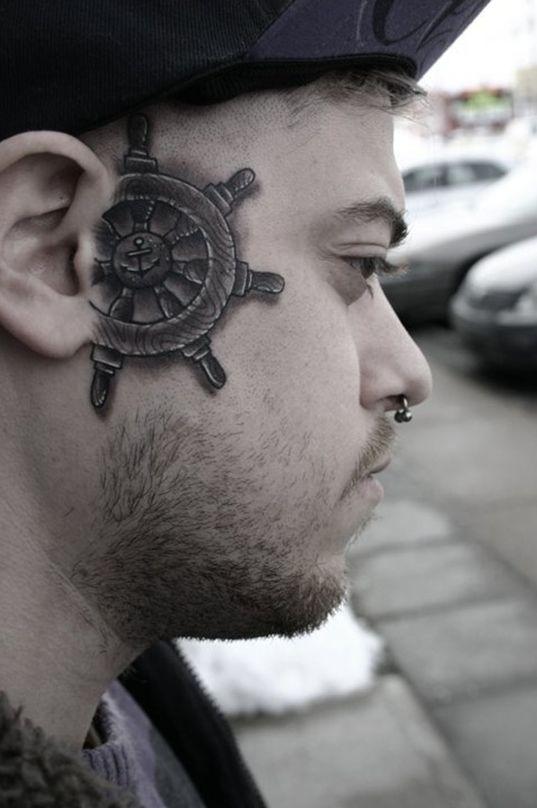 A ship's wheel face tattoo