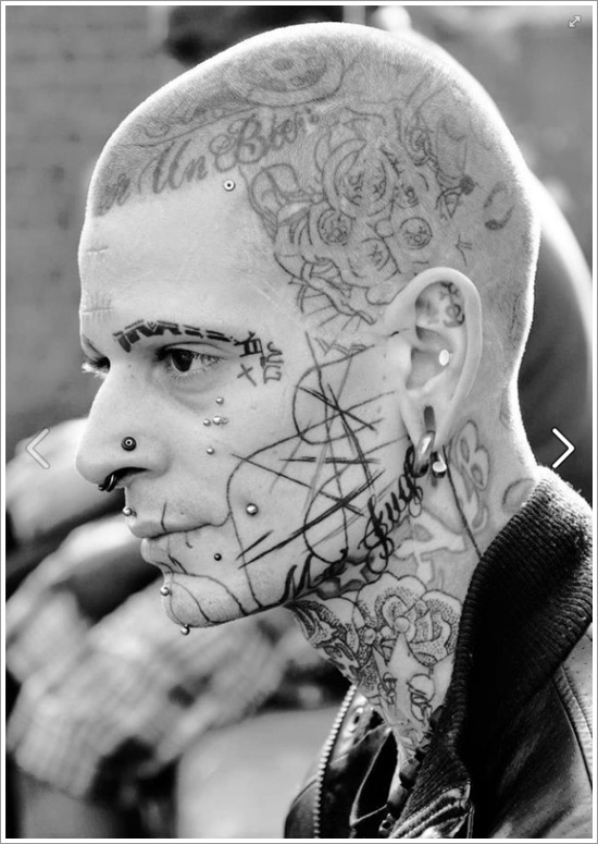 Abstract face tattoo