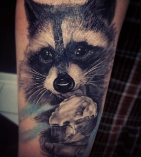 Adorable eating raccoon tattoo