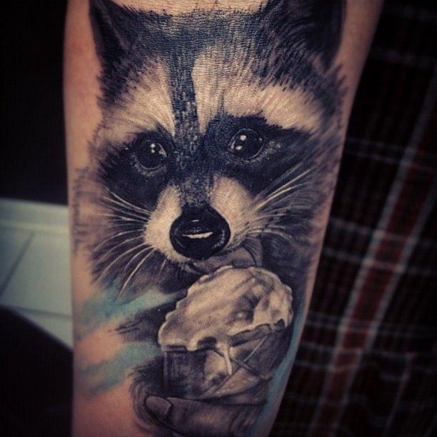 Adorable eating raccoon tattoo