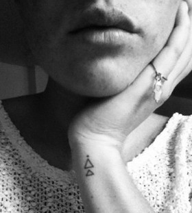 Adorable lips and triangle tattoo