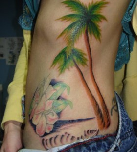 Adorable palm tree side tattoo
