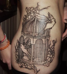 Amazing birdcage side tattoo
