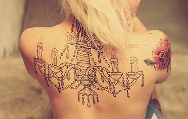 Amazing chandelier back tattoo