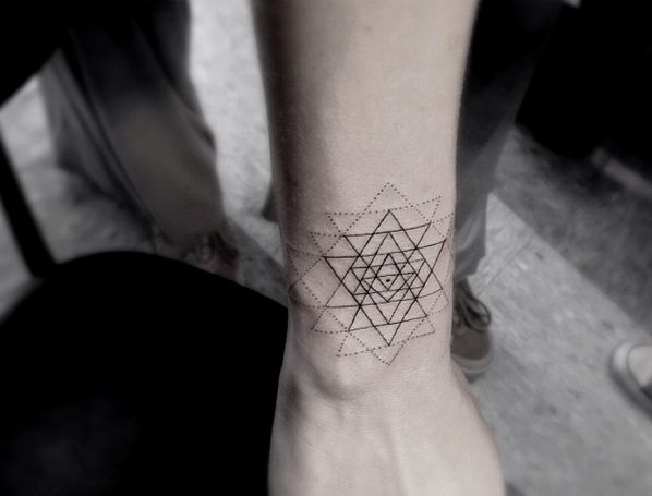 Amazing geometric tattoo by Dr Woo