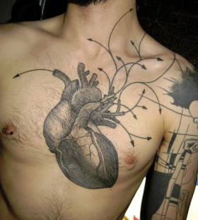 Amazing heart tattoo by Yann Black