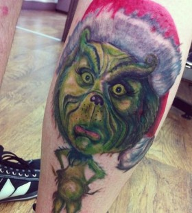 Amazing leg's grinch christmas tattoo